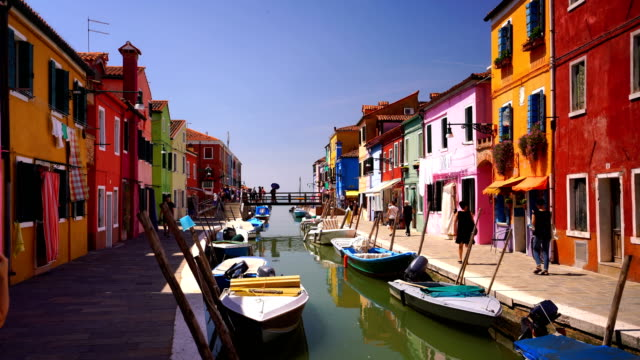 venice landmark, burano island canal, colorful houses and boats - vibrant color stock videos & royalty-free footage