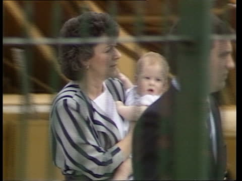 venice ls royal nanny barbara barnes carrying prince harry lr man in front of her holding prince william's hand ms barbara barnes carrying harry lr... - 1987 stock videos & royalty-free footage