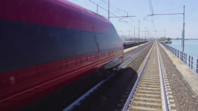 venice train railway transport to venezia s.lucia - ferrovia video stock e b–roll