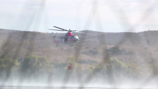 venom with marine light attack helicopter training squadron 303 marine aircraft group 39 3rd marine aircraft wing collects water from lake o'neil to... - base camp stock videos and b-roll footage
