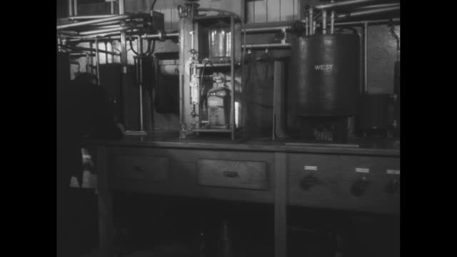 ext ventilation center for maastunnel which runs underneath the nieuwe maas in rotterdam / worker walks past large tanks / instruments in the... - klimaanlage stock-videos und b-roll-filmmaterial