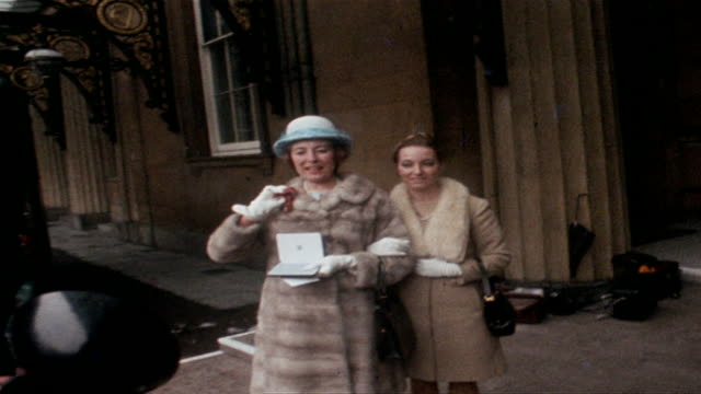 vera lynn showing off her medal outside buckingham palace after receiving an obe, 1969 - colour image stock videos & royalty-free footage