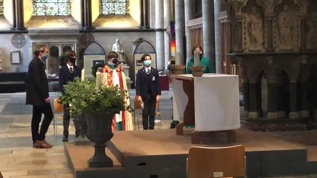 verger joseph davies helps chorister sebastian kunzer to dress and stand correctly as he gets used to wearing bishop's robes while rehearsing his... - role reversal stock videos & royalty-free footage