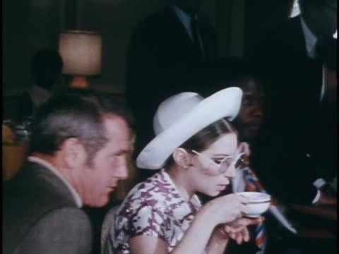 stockvideo's en b-roll-footage met verite medium shot of streisand sitting at desk and drinking coffee - barbra streisand