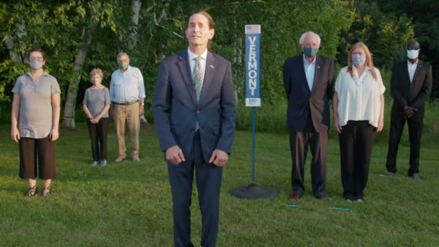 vermont lieutenant governor david zuckerman says with senator bernie sanders, wife jane sanders and others standing behind, that the state of vermont... - social justice concept 個影片檔及 b 捲影像