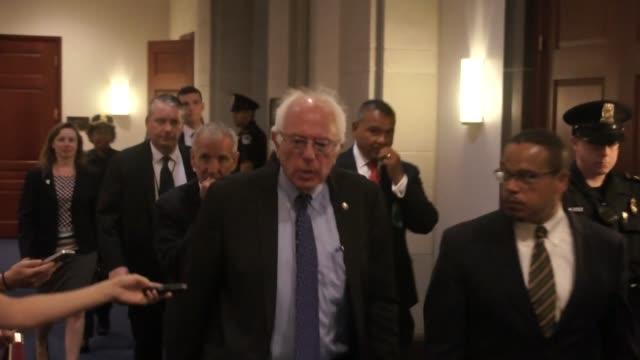 vídeos de stock, filmes e b-roll de vermont senator bernie sanders departs a weekly meeting of house democrats with minnesota congressman keith ellison telling inquisitive reporters... - bernie sanders