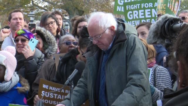vermont senator bernie sanders tells supporters at a press conference to jointly introduce a green new deal for public housing with new york... - paying rent stock videos & royalty-free footage