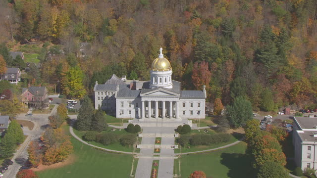 ws aerial pov vermont state house with autumn forest area / montpelier, vermont, unites states - vermont state house stock videos & royalty-free footage