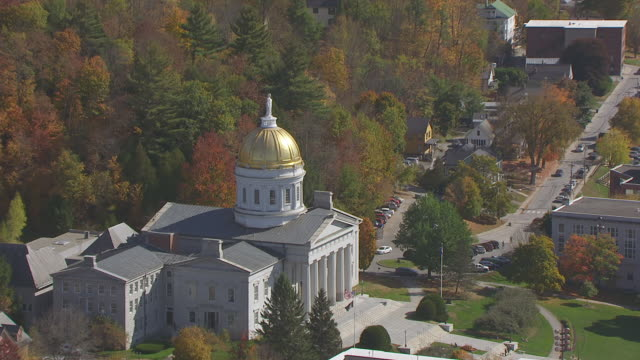 ws zo aerial pov vermont state house with autumn forest area / montpelier, vermont, unites states - vermont stock videos & royalty-free footage