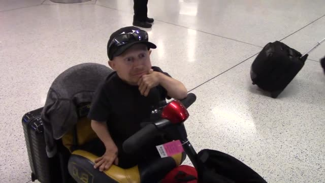 verne troyer talks about doing another austin powers while arriving at lax airport in los angeles - celebrity sightings in los angeles, ca on - verne troyer stock videos & royalty-free footage
