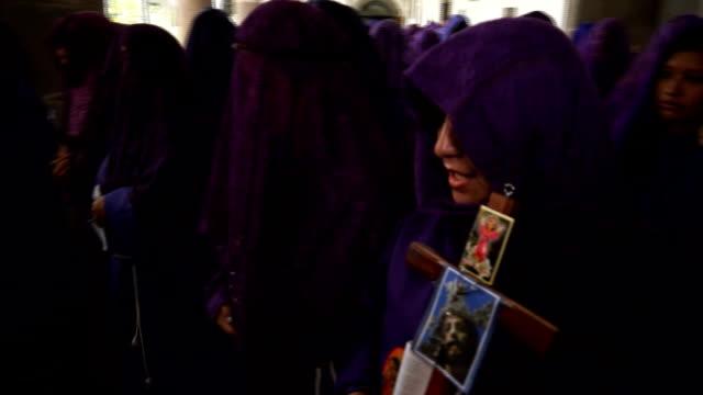 veronicas get ready to enter procession walking along church paths - poder点の映像素材/bロール