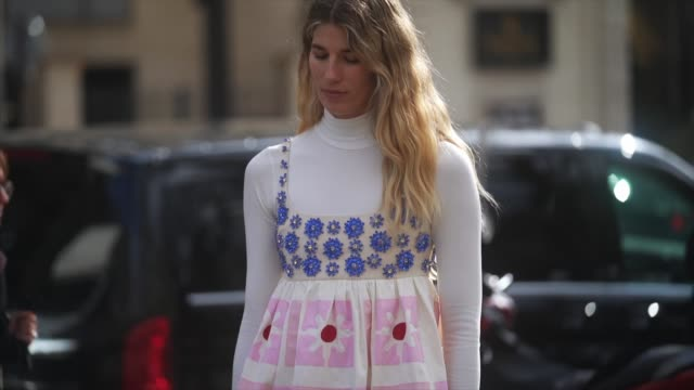 veronika heilbrunner wears a white turtleneck pullover a bejeweled and floral print colored dress gray socks red shoes a bag outside miu miu during... - kleid stock-videos und b-roll-filmmaterial