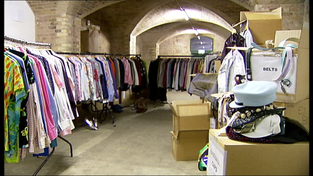 Versace item held by Furnish Dior belts spilling out of box Adidas bag Racks of clothes Reporter looking at shoes Hundreds of pairs of shoes lined up...