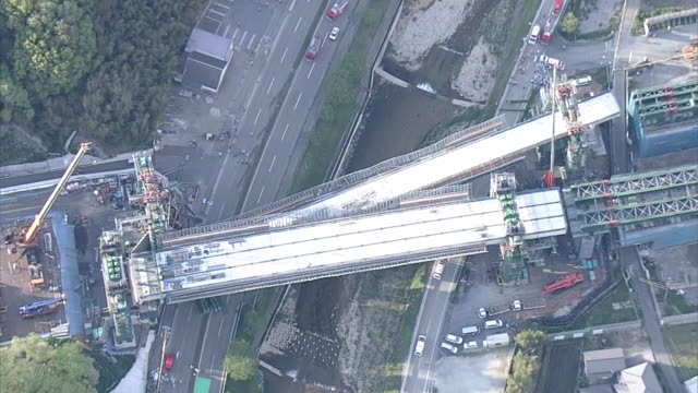 Vertical aerial shot of a bridge under construction as part of the ShinMeishin Expressway fallen onto National Route 176 around 430pm on 22nd April...