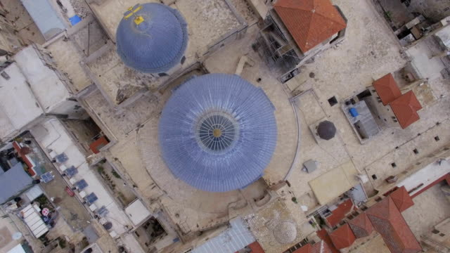vertical aerial view of church of the holy sepulchre - architectural dome stock videos & royalty-free footage