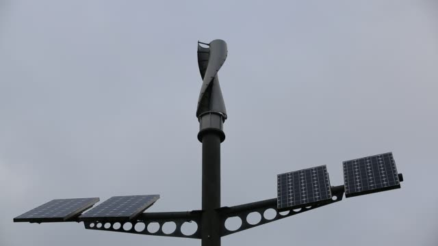 vertical axis wind turbine and solar panels on a post in manchester, uk. - turbine stock videos & royalty-free footage