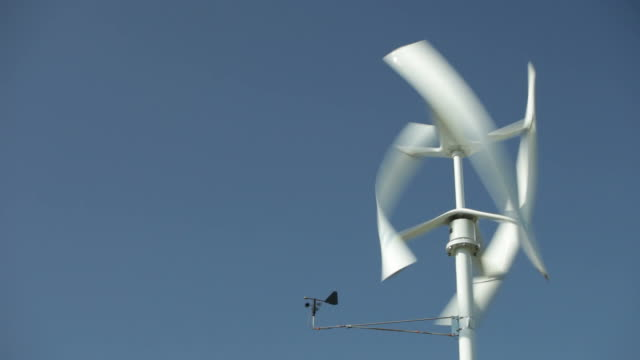 vertical axis wind turbine spinning and generating electricity - small stock videos and b-roll footage
