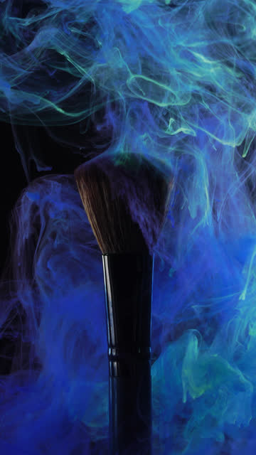 vertical: brush with blue color smoke on black background - painting art product stock videos & royalty-free footage