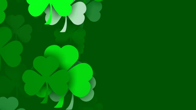 vertical composition, copy space, shamrocks, for saint patrick's day (loopable) - st. patrick's day stock videos & royalty-free footage