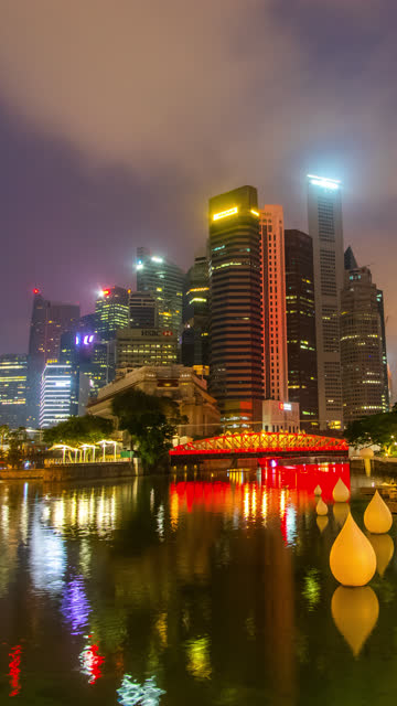 vertical day to night timelapse of singapore cityscape - river singapore stock videos & royalty-free footage