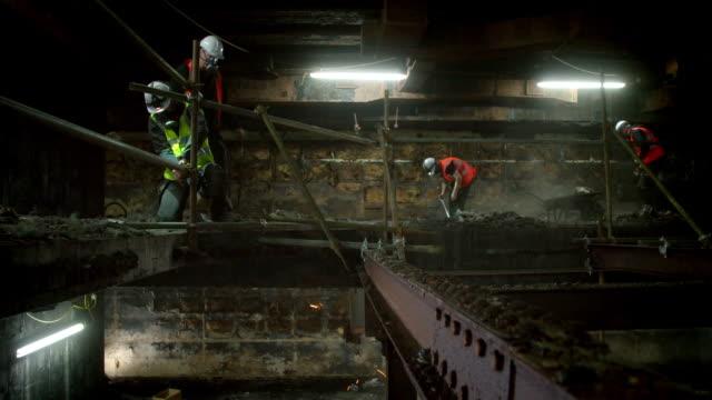 vertical descending view of volunteers restoring barnton bunker - bbc news stock videos and b-roll footage