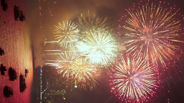 vertical fireworks over pattaya beach, thailand. - firework display stock videos & royalty-free footage