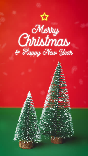 vertical merry christmas and happy new year with xmas tree decoration on green table with vivid red and snowing background.holiday celebration greeting card - new year card stock videos & royalty-free footage