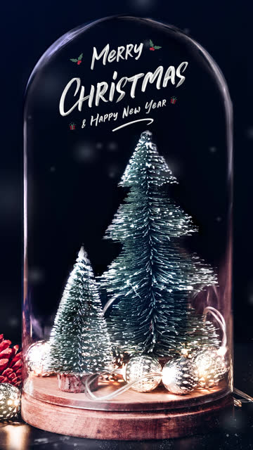 vertical merry christmas and happy new year writing over tree and glowing light string and pine cone decoration at blue background snow falling.winter holiday greeting card.background for social media on mobile - vertical stock videos & royalty-free footage