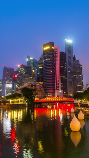 vertical night to day timelapse of singapore cityscape - river singapore stock videos & royalty-free footage