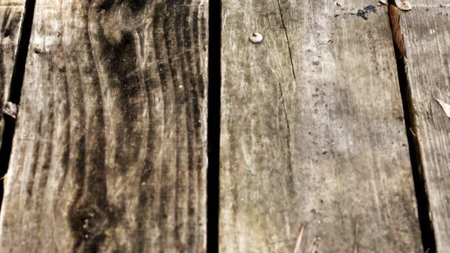 Vertical pan of wooded deck.