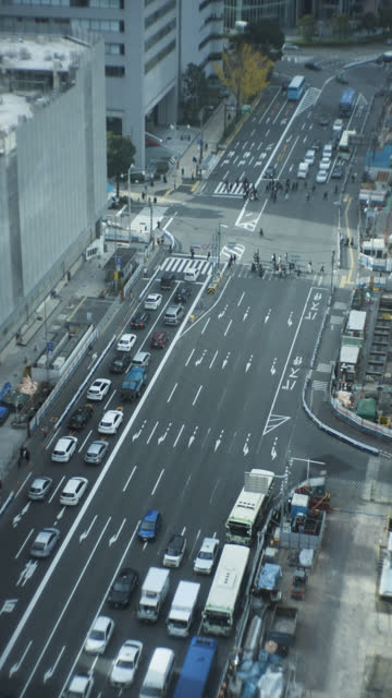 Vertical position 4k video that bird's-eye view of transportation in Osaka, Japan