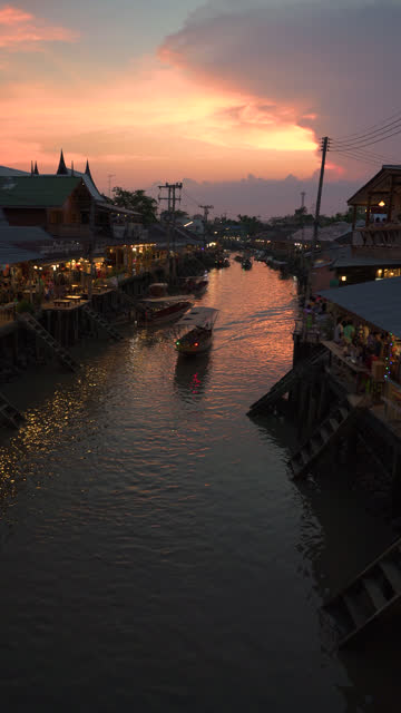 vertical shot of amphawa floating market in twilight time. - vertical stock videos & royalty-free footage