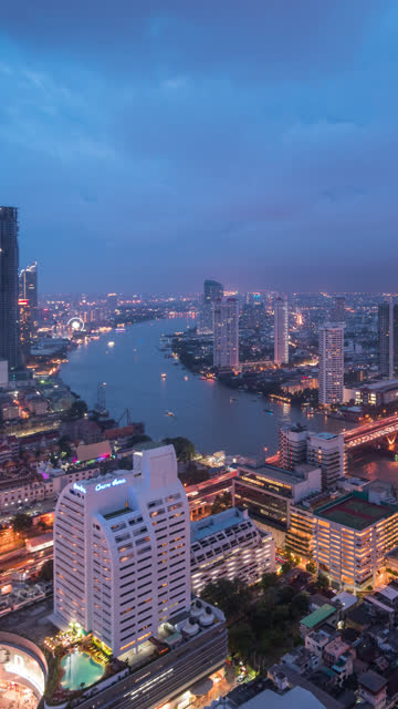 Vertical shot of Bangkok city,Day to Night Time lapse