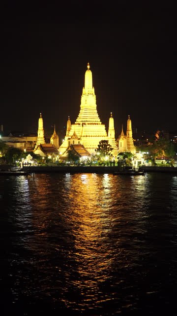 Vertical shot: Wat Arun Temple (Temple of Dawn) in night time, Bangkok, Thailand.