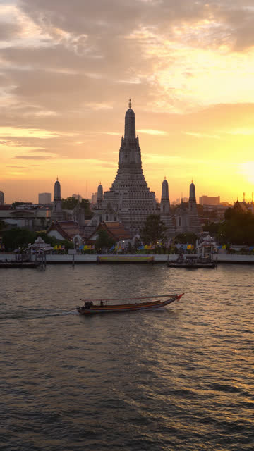 Vertical shot: Wat Arun Temple (Temple of Dawn) in sunset time, Bangkok, Thailand.