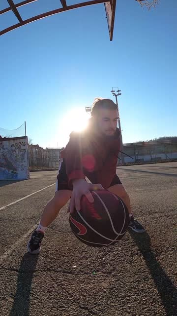 vertical slow motion video. basketball player dribbling. with hard training to success, a promising basketball player. - basketball player stock videos & royalty-free footage