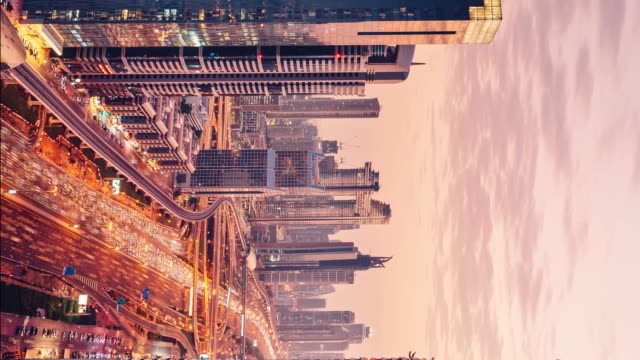 vertical time lapse - dubai skyline and traffic vein at sunset - famous place stock videos & royalty-free footage