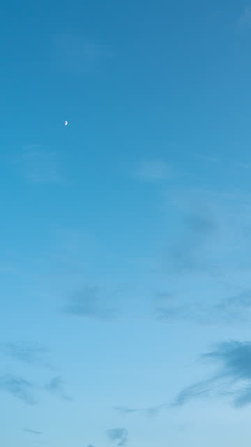 vertical time lapse moon on blue sky background with clouds at twilight - vertical stock videos & royalty-free footage