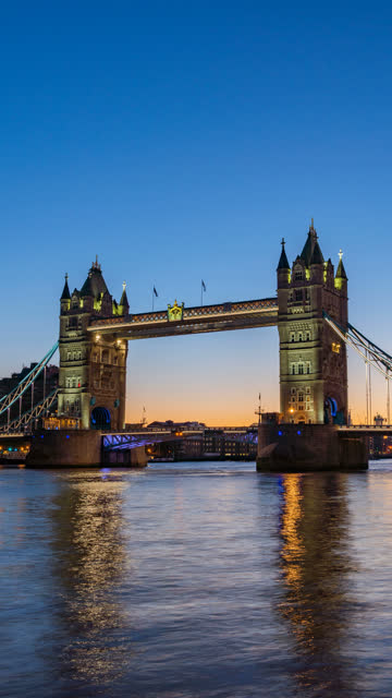 vertical timelapse morning sunrise at tower bridge, london, uk, england - tower bridge stock videos & royalty-free footage