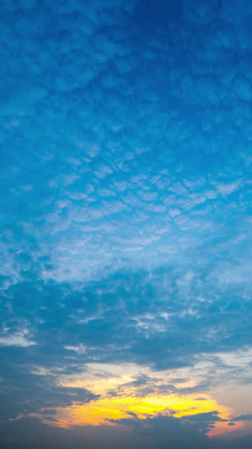 vertical timelapse of cirrocumulus moving in colorful cloud and sky at sunset time - cirrocumulus stock videos & royalty-free footage