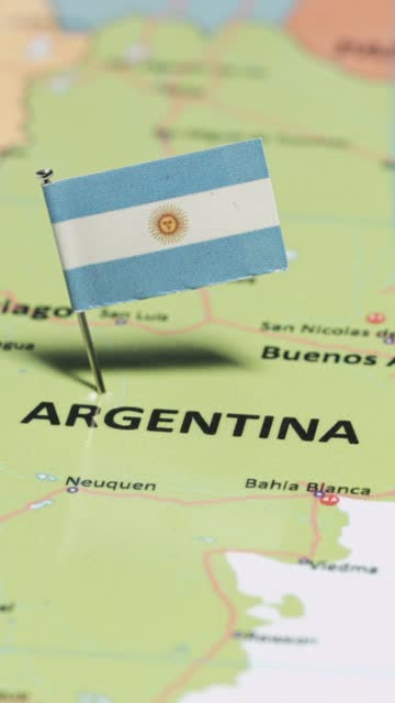 vertical video of argentina with national flag - argentina stock videos & royalty-free footage