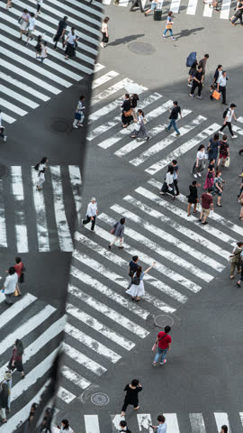 vertical video of busy traffic timelapse of people and transportation at zebra crossing in reflection - shibuya crossing stock videos & royalty-free footage