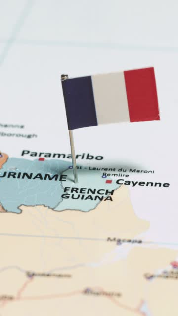 vertical video of french guiana with national flag - french overseas territory stock videos & royalty-free footage