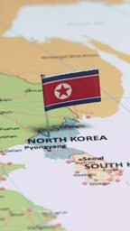 Vertical video of North Korea with national flag