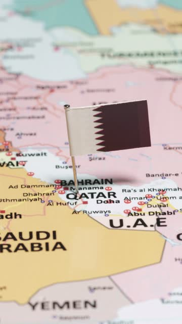 vertical video of qatar with national flag - basra stock videos & royalty-free footage