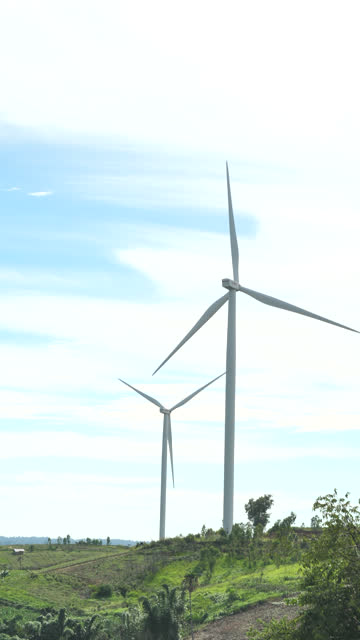 vertical view  of wind turbine at sunset clean energy concept - compact fluorescent light bulb stock videos & royalty-free footage