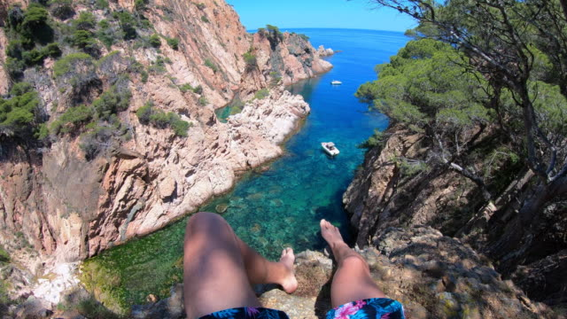 vertigo view of the costa brava shoreline during summer vacations. - barefoot stock videos & royalty-free footage