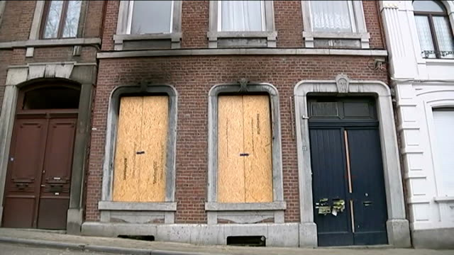 five people charged with terrorism offences belgium verviers ext apartment building with boarded up windows where police officers shot dead two men... - counter terrorism stock videos & royalty-free footage