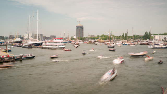 time lapse: very busy day in port of amsterdam - canal stock videos & royalty-free footage
