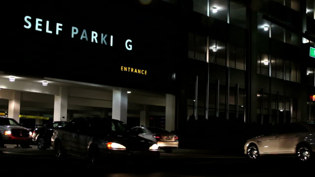 very busy self parking lot garage structure. - car park stock videos & royalty-free footage